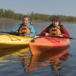 2 kids in kayaks