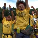 Kids celebrate big eco race win