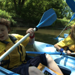 kids take off in kayaks
