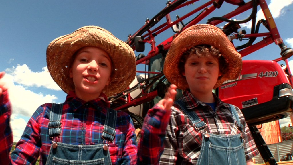 2 kids by tractor