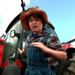 boy by tractor