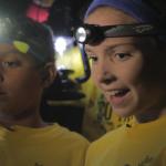 Kids explore cave limestone