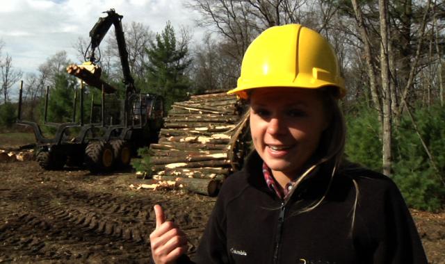 woman by logs