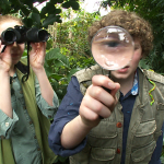 boy and girl looking with magnifiers
